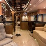 2010 Millennium H3-45 Stock #798 - View from sitting area back through kitchen and open bedroom door