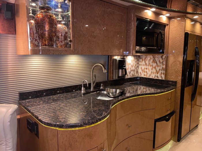 2010 Millennium H3-45 Stock #798 - Kitchen with sink, cabinets, microwave, refrigerator