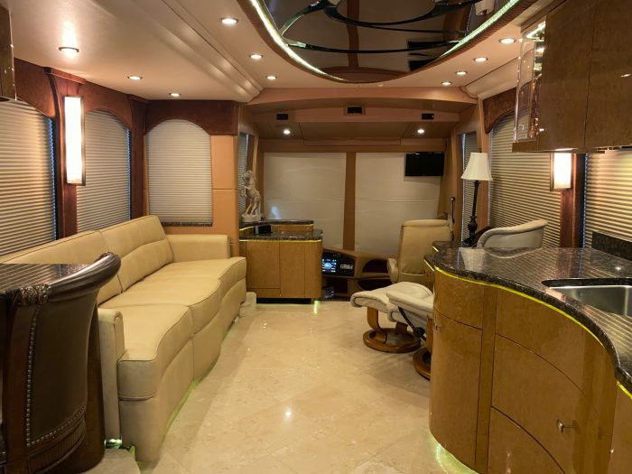 2010 Millennium H3-45 Stock #798 - View from kitchen and dining area into sitting area and front of coach