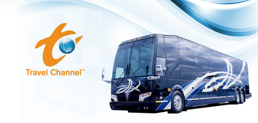 Dark blue coach and the Travel Channel logo